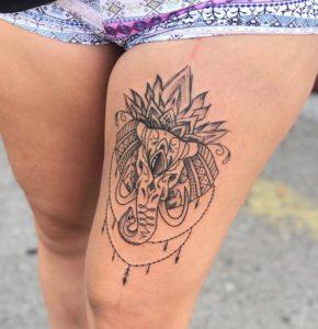 Tatuaggio coscia Milano